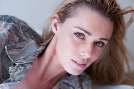 female soldier: Sexy Lady in Camouflage shirt looking at Camera