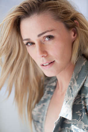 army girl: Pretty Camouflage woman feeling remiss for her soldier Stock Photo
