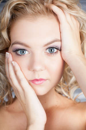 Pretty blond girl with a pensive look Stock Photo