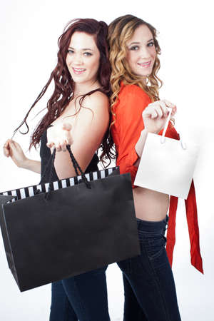 Gorgeous women Smiling holding shopping bags isolated on white photo