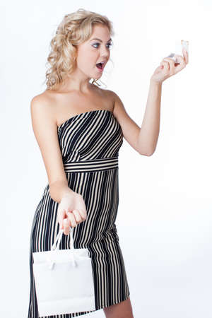 Ecstatic young woman holding  small gift box and bag in awe of her new ring Stock Photo - 15922100