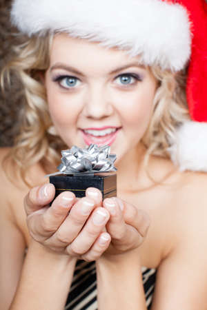 make a gift: Beautiful Blonde woman with a little gift cupped in her hands Stock Photo