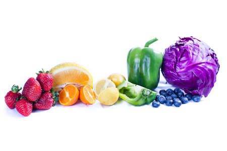 Fruit and vegetables in a selection to represent a rainbow