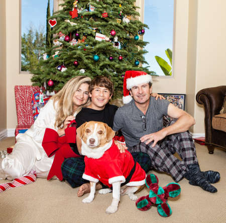 Family and their dog in front of decorated Xmas Tree California photo