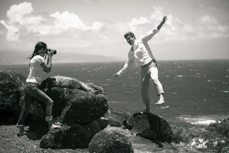Tourist on a Bluff in Hawaii taking Pictures having fun photo