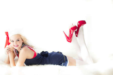 Young Beautiful Woman Pin up style on white fur rug in Red Shoes photo