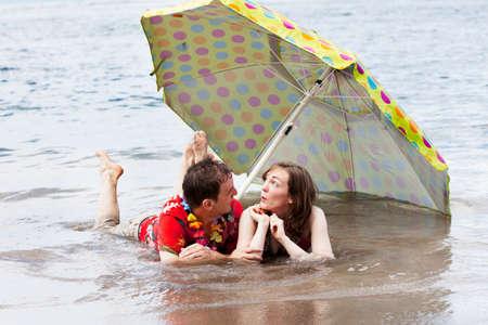 Coouple floode by water under an umbrella photo