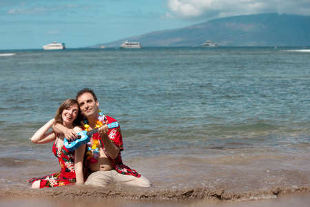 Man Serenading his new bride with a Ukelele in Hawaii photo