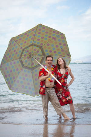 Tourist in matching outfits dancing with an Umbella in Hawaii photo