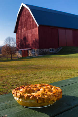 old red barn: Homemade Apple Pie outside to cool with an old red barn in the background