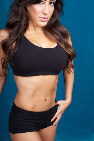 female muscle: Pretty fit woman partially cropped focus on her abdominals