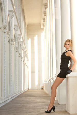 Glamourous  Beautiful woman wearing black in a gorgeous columned cathedral