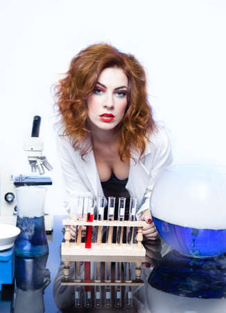 Beautiful Sexy woman Scientist with a test beaker of Love Potion fresh for Valentine