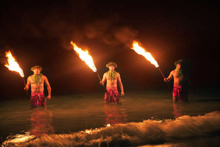 Three Maui Men Juggling Fire in Hawaii - Fire Dancers photo