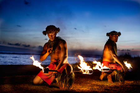 Two Hawaiian Men preparing to Dance with Fire in Maui photo