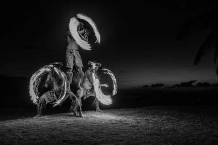 Hawaiian Fire Dancers Maui Black and white image in the Pacific Ocean photo