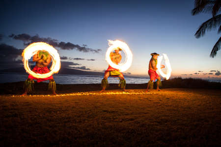 only mid adult men: Three Men Juggling Fire in Hawaii - Fire on the Beach