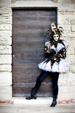 Woman as a Jester in Venice Italy at Carnival in February photo