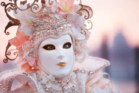 painted face mask: Venetian Masked Woman at Sunrise in Venice Italy Stock Photo