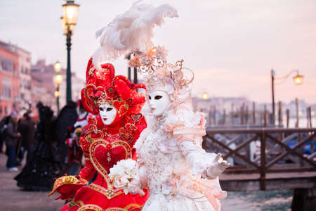 Sunrise in Venice Italy in front of the Grand Canal  Beautiful costumed woman Standard-Bild