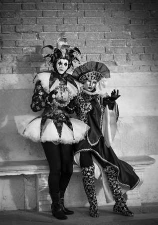 Costumed women in Venice Italy at Carnival in February photo