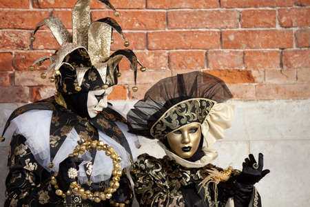 Beautiful costumed women in Venice Italy at Carnival in February photo