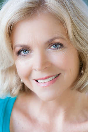 beautiful middle aged woman: Beautiful Middle Aged Woman in her fifties looking at camera