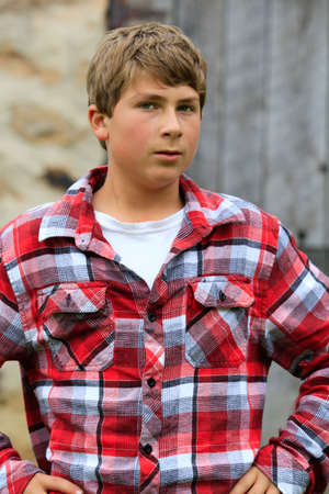 one boy only: Serious Teenager boy in plaid shirt
