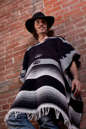 Handsome Young Man in Poncho photo