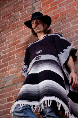 serape: Handsome Young Man in Poncho Stock Photo