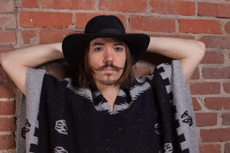 The Mustached Man in a Poncho photo