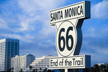 End of the trail sign on Santa Monica Pier with Skyline in the background photo