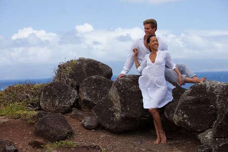 honeymooners: Honeymooners in Hawaii above the ocean on a Lava bluff