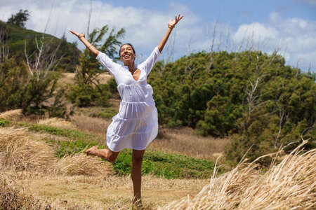Pretty woman in joy in the country of Maui photo