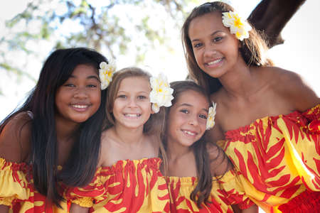 people in a row: Group of four Polynesian Hula girls  in Friendship looking at camera