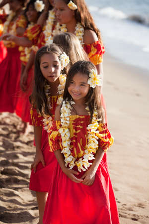 Polynesian Hula Dancers at the Ocean in Hawaii Stock Photo