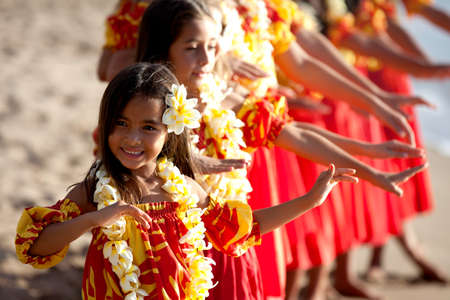 Hula girls on the beach with Hands raised photo