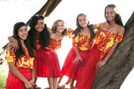 Group of fivePolynesian Hula girls  in Friendship looking at camera