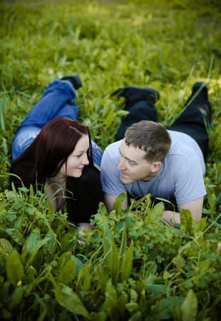 Man and woman looking at each other on the ground in tall grass Stock Photo - 17425036