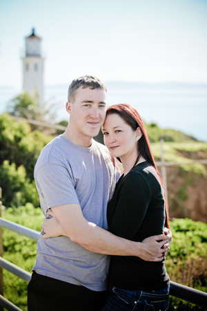 Romantic couple in front of a Lighthouse in Palos Verdes  California photo