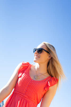 Beautiful Young Woman over blue Sky photo