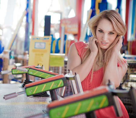 amusement park ride: Beautiful woman at an Amusement park playing a game
