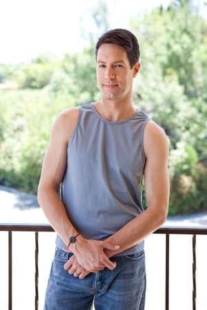 탱크 탑: Good looking guy in tank top and jeans