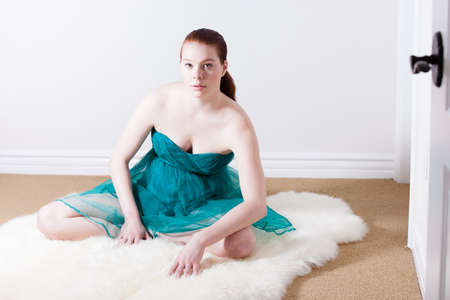 latin american ethnicity: Pretty Dancer on a fur rug in a spring time dress