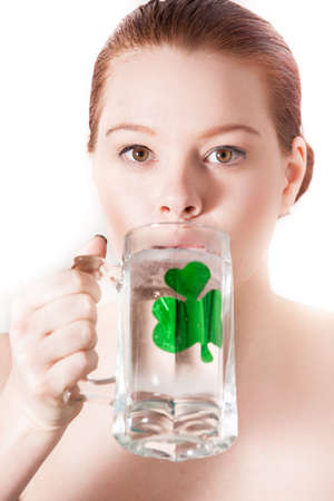 Beauty face woman and a shamrock Young beautiful model. Close up celebrating the Irish on St Patrick's Day Stock Photo - 17927509
