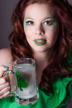 Pretty young woman and a shamrock  celebrating the Irish on St Patrick's Day Stock Photo - 17927505