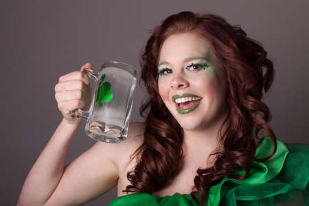 Pretty young woman and a shamrock  celebrating the Irish on St Patrick's Day Stock Photo - 17927516