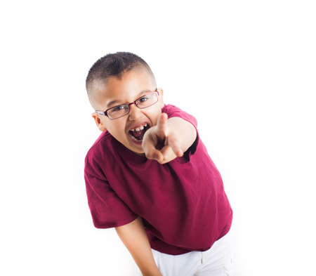 child finger: Latin child pointing with his finger Isolated on white background  Boy wearing glasses