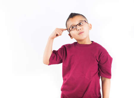 Hispanic child in thought Isolated on white background  Boy wearing glasses with a big Idea photo