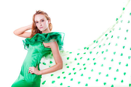 Pretty Blonde Irish Woman in Green and a shower of Shamrocks in March for St Patrick Stock Photo - 18122761